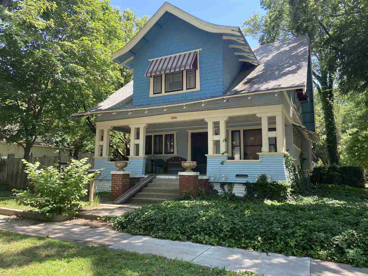 Original woodwork, beamed ceilings, original wood floors. Great front porch, patio, and deck. Large