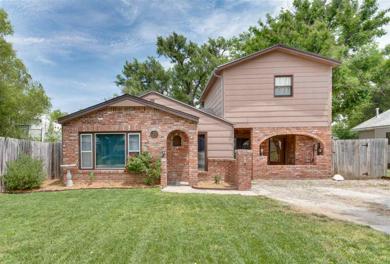 This cute and cozy 1 1/2 story brick home is waiting for you! Recently remodeled bathroom, fresh pai