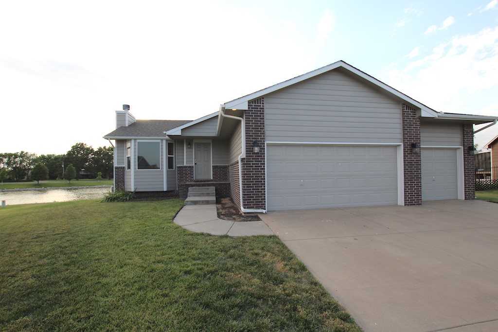Great home in Goddard.  4 br 3 ba fin bsmt 3 car garage. Beautifully remodeled complete with open fl