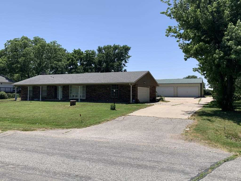 All brick ranch style home on 1/2 acre with HUGE shop.  A little bit country and a little bit city.