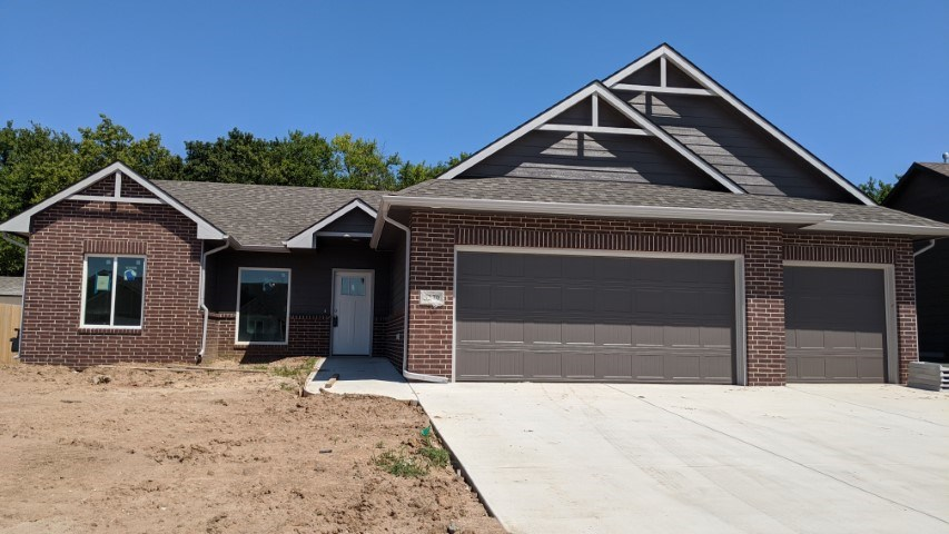 Comfort Homes Popular Nolan Jr layout on a wooded lot.  This home is being built with a no step entr