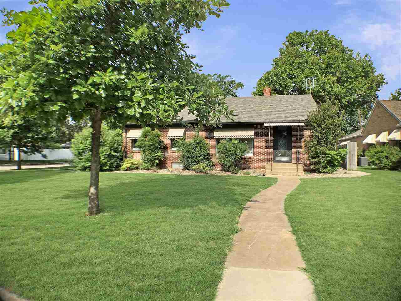 Darling all-brick ranch home on beautiful corner lot in North Riverside.  2bd, 2ba, 2car (detached) 2001 square foot home.   Walk into character and see the quaint living room's fireplace and built in shelves. Upstairs has 2 bedrooms, a bath, kitchen and dining room with beautiful wood flooring. Basement offers a large living room and non-conforming area with closet which can be great for extra sleeping space, gym or office.  Off to the side of the stairs is a large laundry room, bathroom and storage space. Enjoy summer nights on the cozy, paved private patio between home and garage.  The second chain-link fenced side yard  is perfect for kids and pets to play.