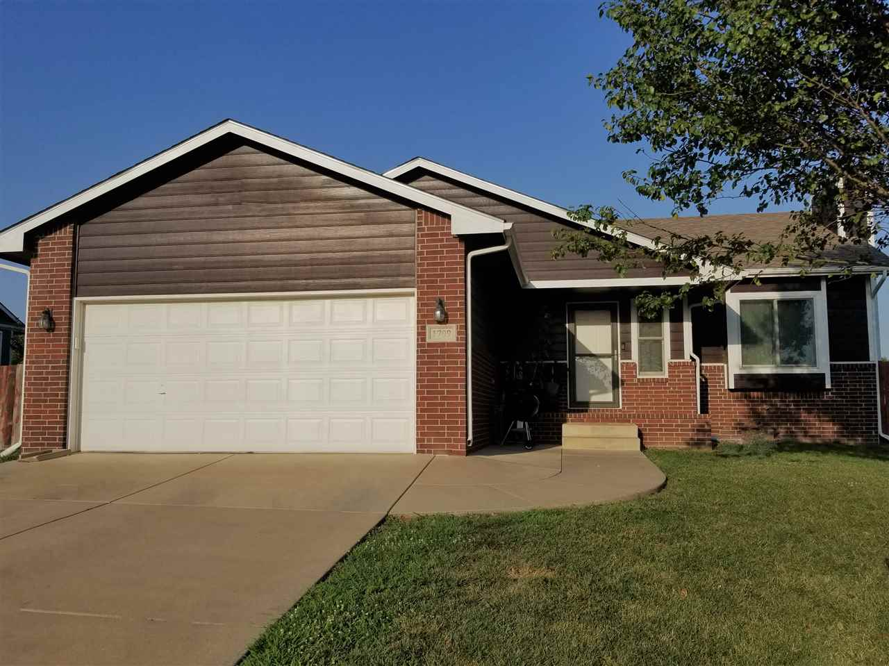 Beautifully updated home in Mulvane! Upstairs you'll find gorgeous bamboo floors throughout the livi