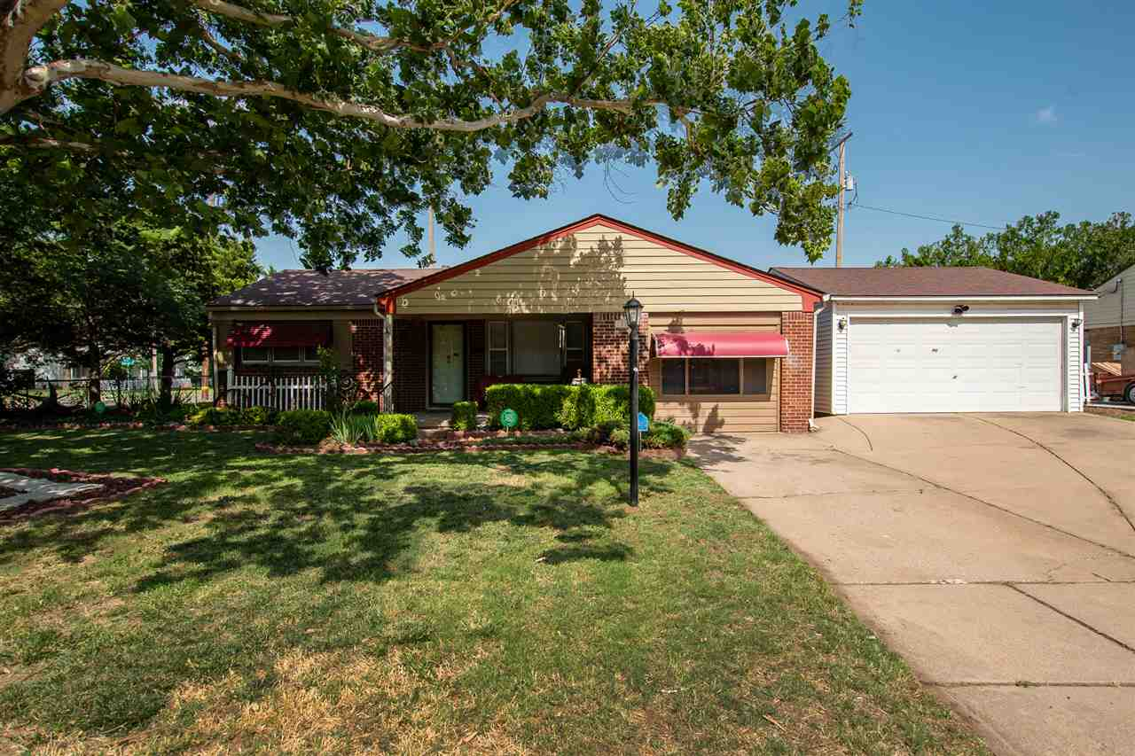 Cute Brick 3 bedroom 1 bath ranch with newer oversized 2 car detached garage on corner lot with addi