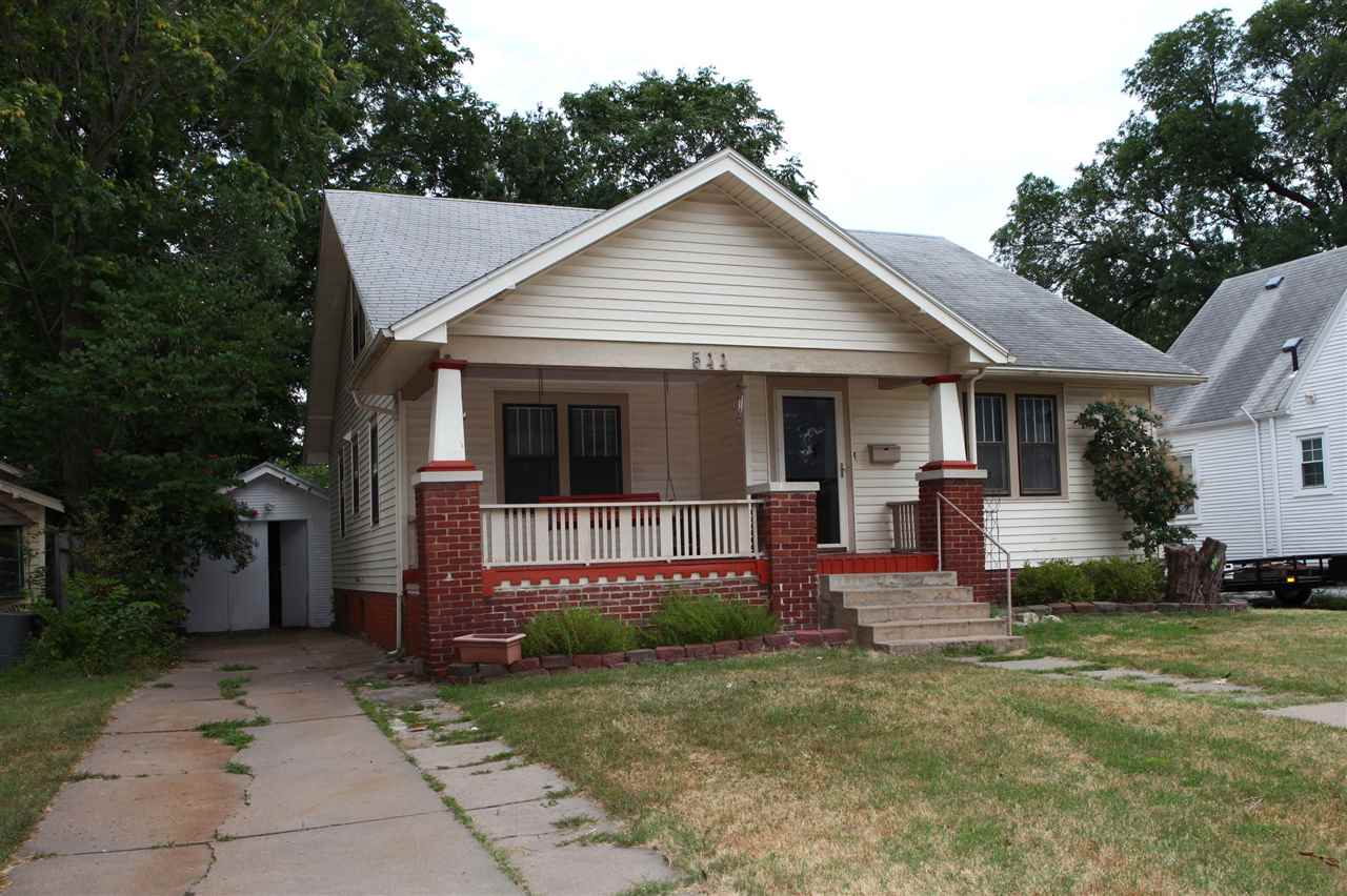 Charming 3 bedroom 2 bath 1.5 story bungalow located in an established neighborhood with many mature