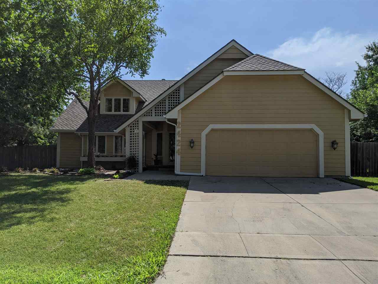 Tucked away in the Sycamore Village neighborhood in northeast Wichita, this five bedroom estate is y