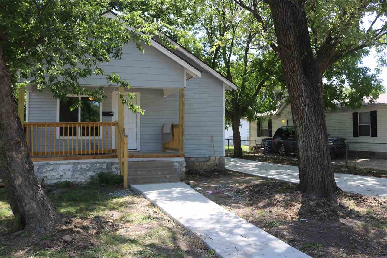 Fully remodeled home! This three bedroom/two bath bungalow is completely remodeled! Siding, roof and