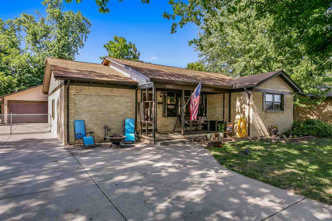 Charming brick ranch complete with hardwood floors, fresh interior paint, lovely living room with cr