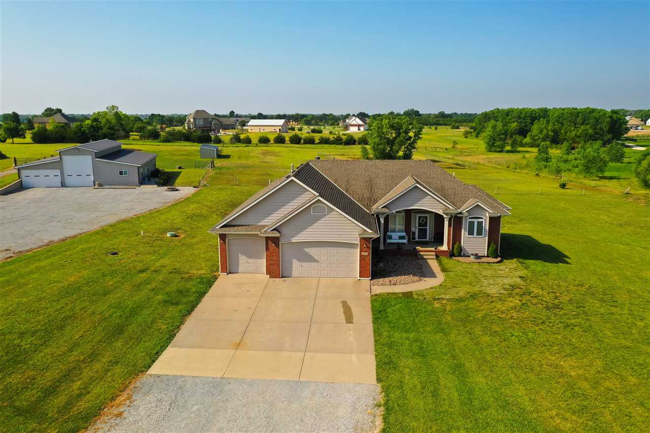 Imagine rural living on 4.66 acres just a few miles north of the city, in a home with charm for days