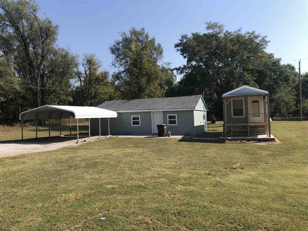 If you are looking to simplify your life in a peaceful neighborhood with a huge yard than this is the is the property for you. This 1 bedroom and 1 bathroom home is just what you are looking for. This house was built in 2019 and sits on over half of an acre with a 26x36 finished shop that is fully insulated, heated and cooled  with a new roof it is a great place for year around projects. The yard is big enough for a huge garden and additional shops. SELLER IS WILLING TO PAY BUYERS CLOSING COST UPON AN ACCEPTABLE OFFER. Call today to schedule your private showing!