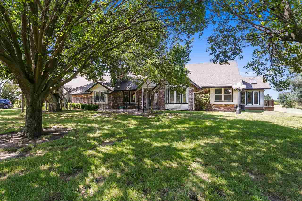 3 bedroom 3 full bath ranch style home built in 1977 on 12+- acres between Wichita & Benton, Kansas.
