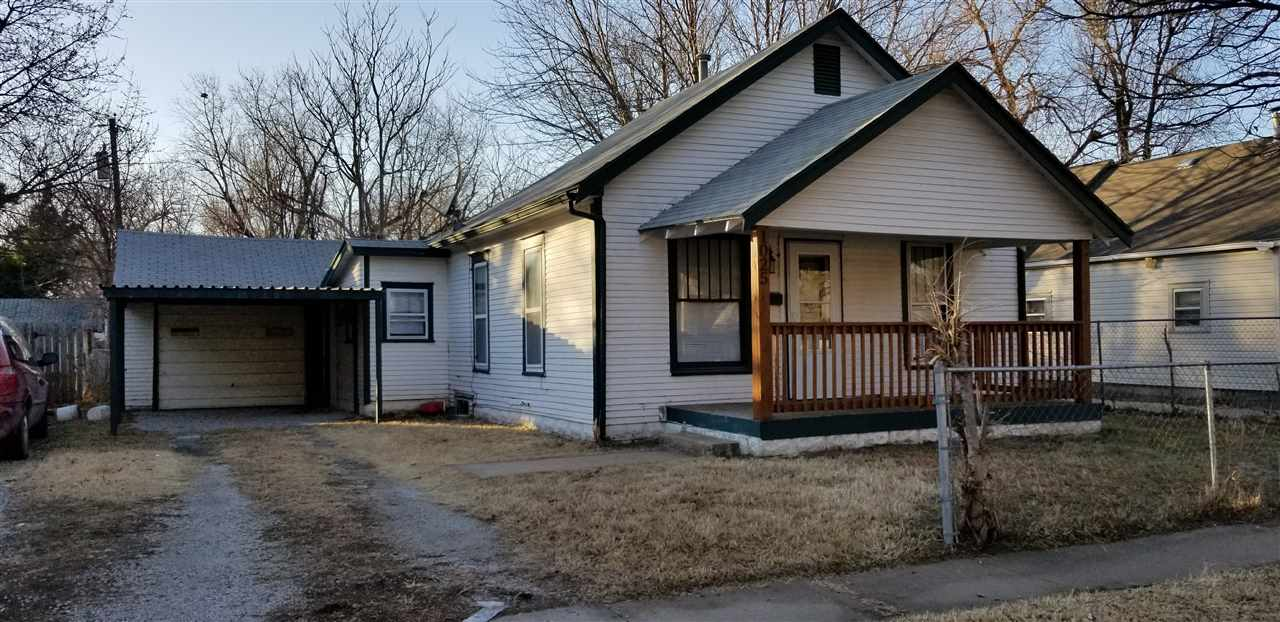 Investor Alert!! Cute 2 bedroom, 1 bath home with attached over-sized garage. Fenced in back & front