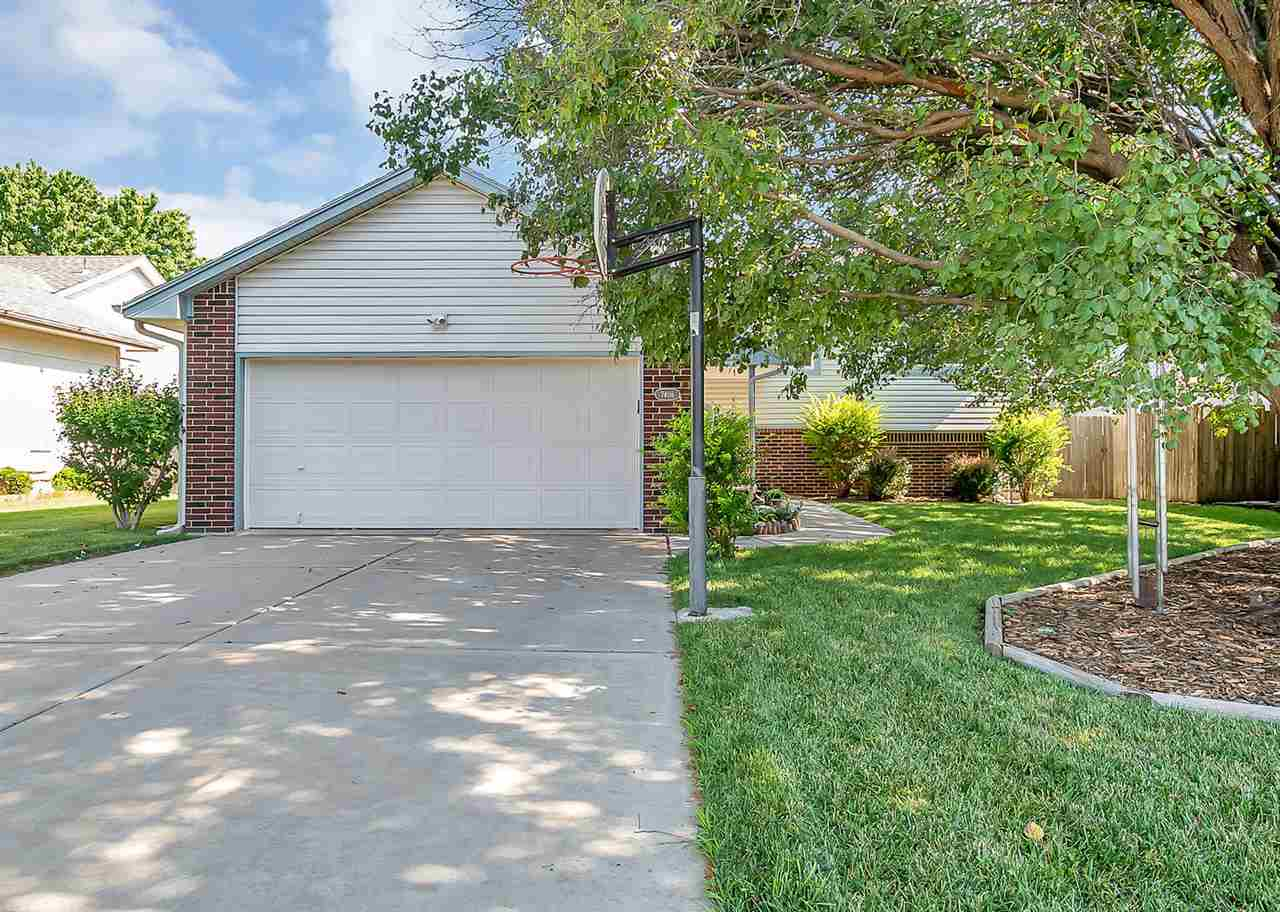 Great 5 bedroom, 3 bath home in NE Wichita.  Newer siding, windows & doors, roof & guttering (with g