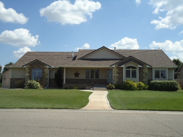 Beautiful Andale 5 Bed/3 Full Bath Home sitting on .38 acre corner lot with Full Privacy Fence! Char