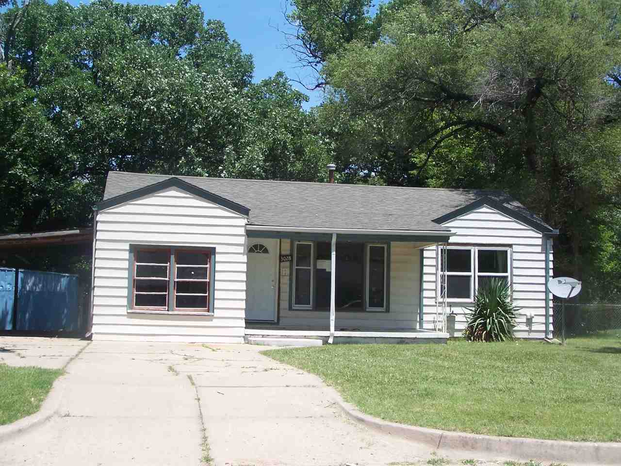 This 3 bedroom, 1 bath, ranch home sits on a good sized fenced lot with a shed. There is a carport a