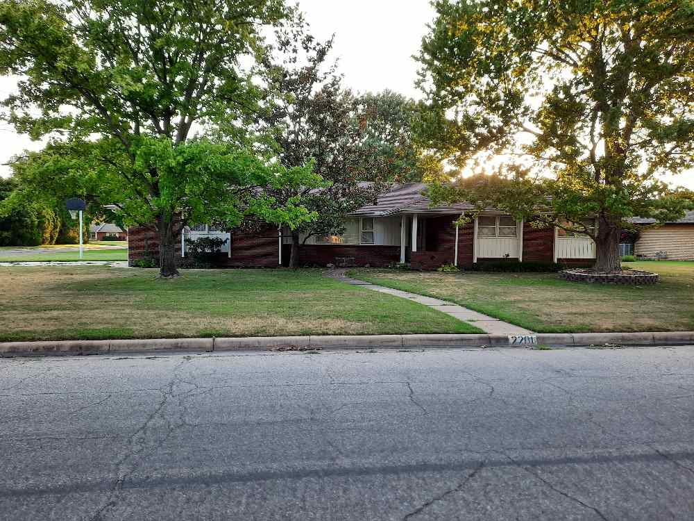 Beautiful brick home in desirable Northwest Wichita. Well manicured landscapping with numerous trees