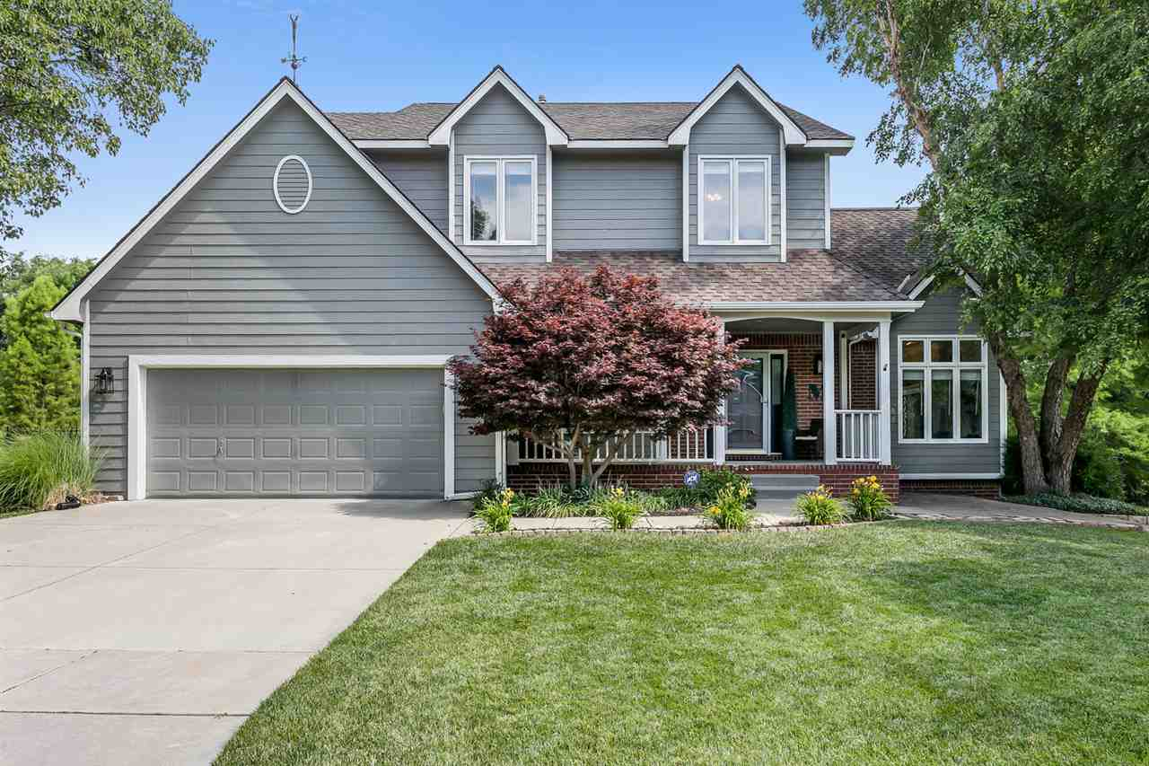 Updated 5 Bed/3.5 Bath Home in White Tail.  Andover Schools.  No Specials.  This home has been taste