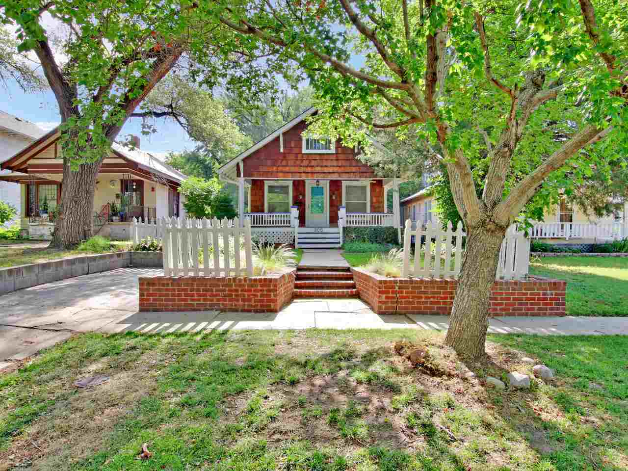 You're going to fall in love with this charming College Hill Bungalow surrounded by a picket fence!