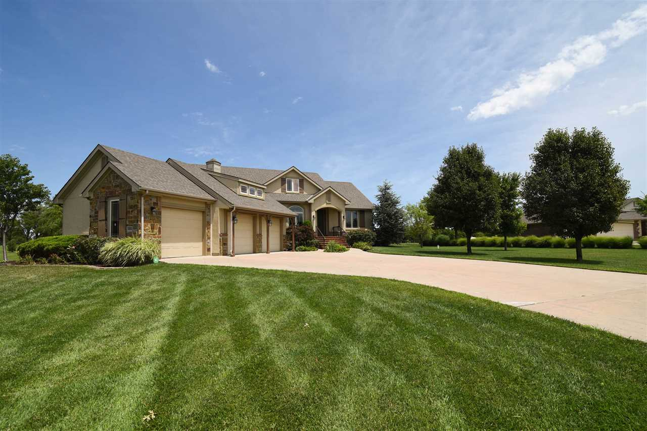 What an impeccable country estate yet so close to all the city has to offer!! This custom built 4 BR