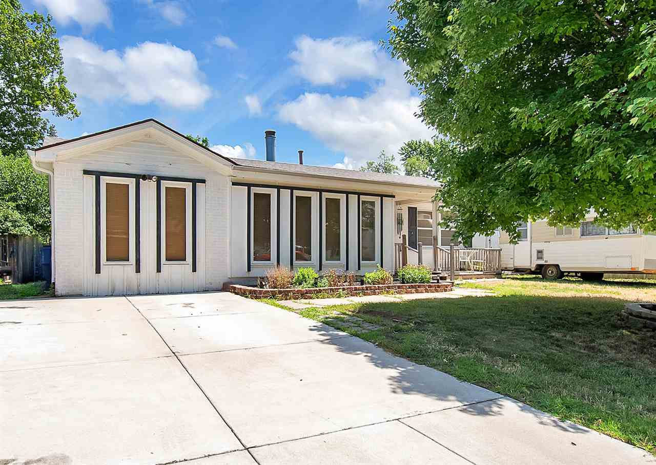 You don't want to miss this one!  From the outside it is just a home in quiet neighborhood,  but whe