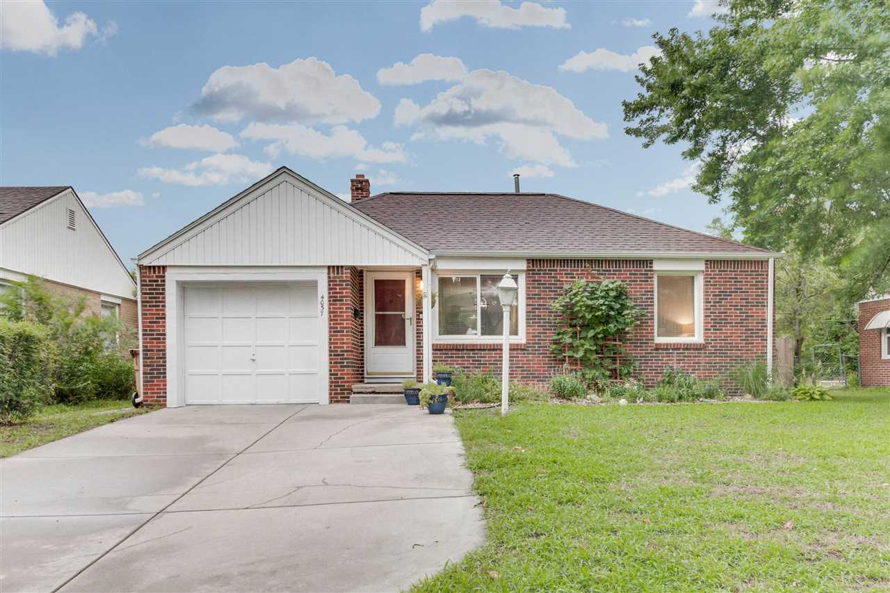 This is a charming full brick,  2 bedroom, 1 bath home close to WSU that backs up to the paved walki