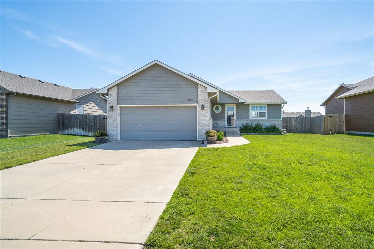 What an incredible location on Wichita's west side with the privacy of a quiet cul-de-sac. Welcome t