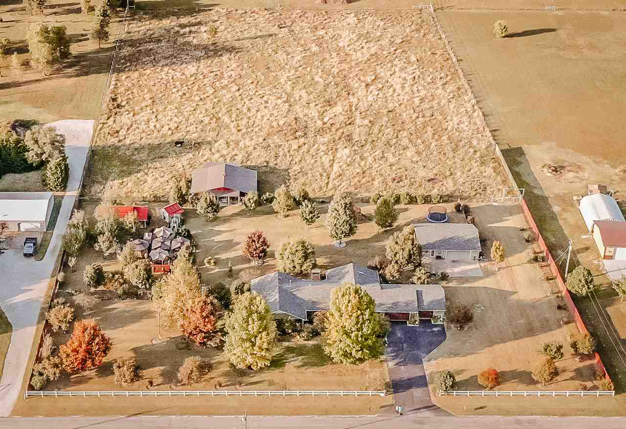 Gorgeous inside and out. This completely updated 7+ acre, ranch style home boast 3 bedroom, 2 and a