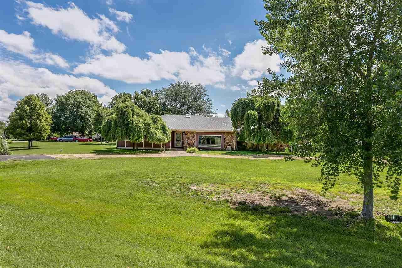 Enjoy .7 acre lot with circle drive, mature trees, side load garage, and space on the lot to park/st