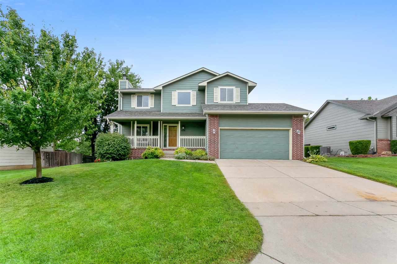 Clean as a whistle and move-in ready!  Great Curb appeal and Lush Landscaping.  Living room has a wo