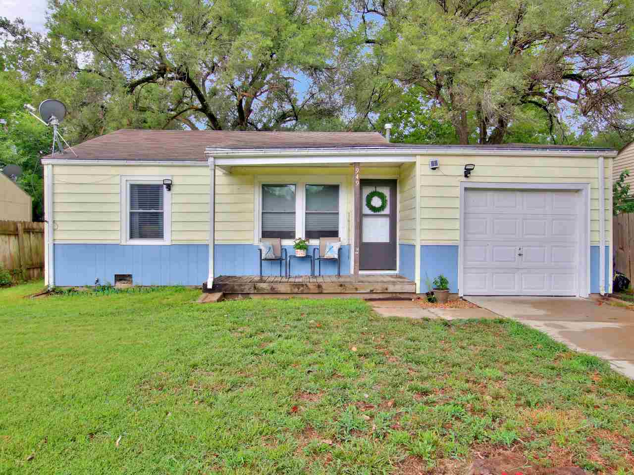 This cheerful, bright ranch will have you hooked from the moment you drive up.  The spacious front p