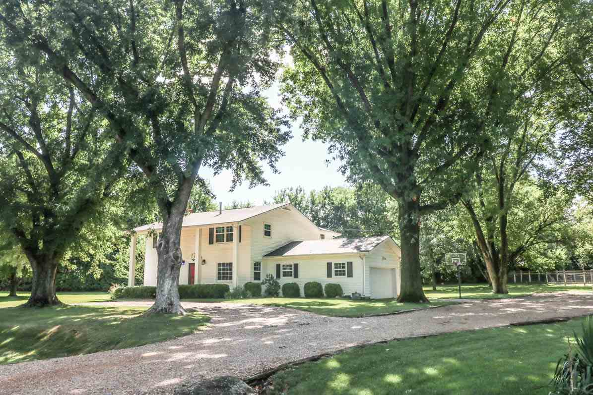 Check it out!  Nearly 3/4 acre in town!  Stately (vinyl sided) 4 bedroom, 2 1/2 bath older home with