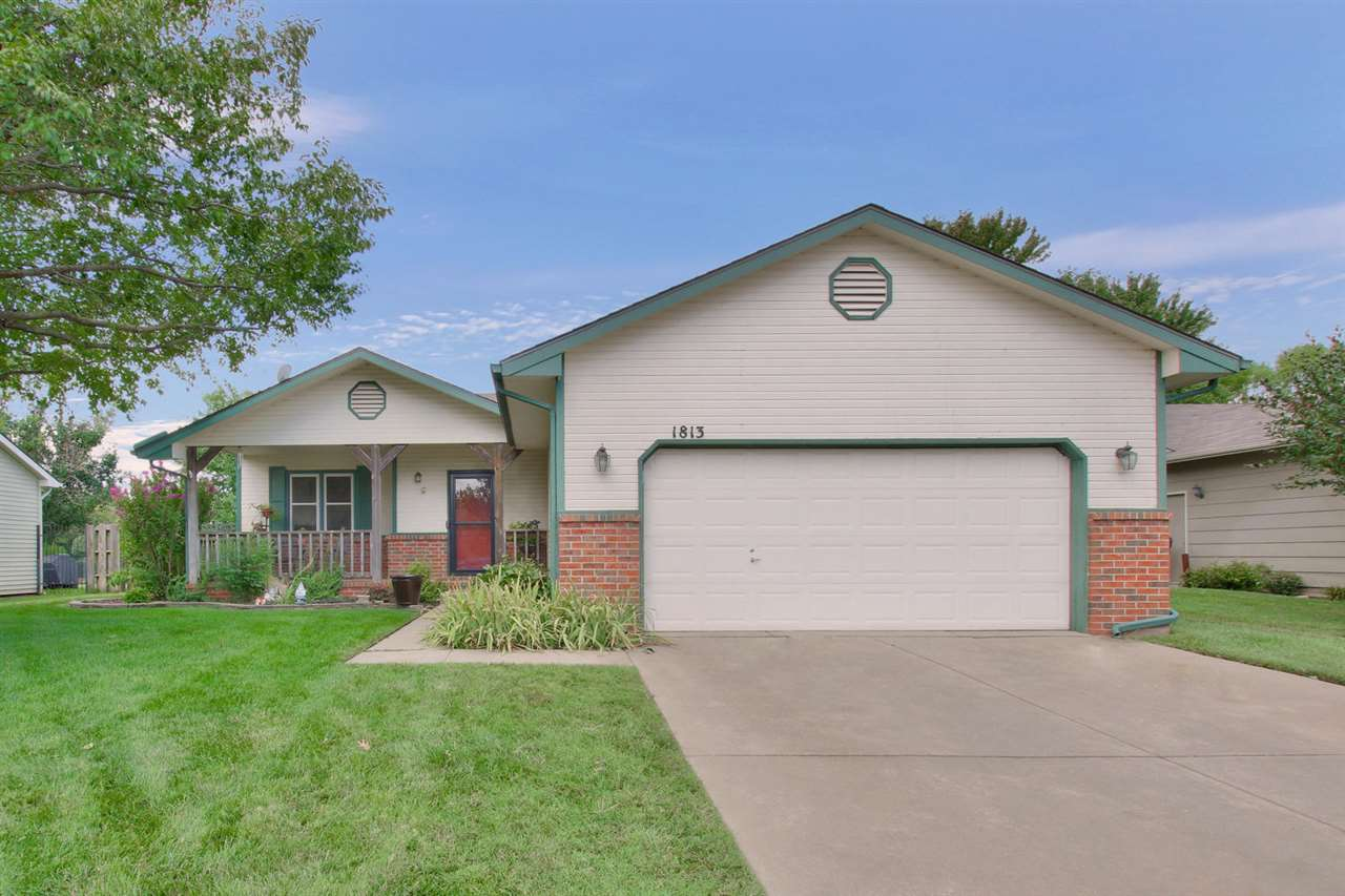 Nicely updated ranch on a beautiful LAKE LOT with a newer covered patio to enjoy while entertaining