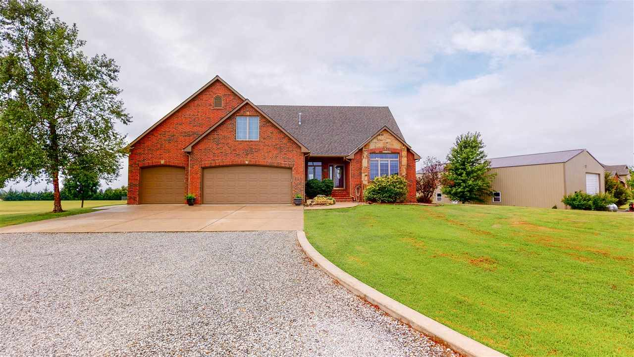 LOCATION, ACREAGE, CUSTOM, SPACE & BUILDING! Fantastic Custom Home & 35'x68' Building! sits on nearl