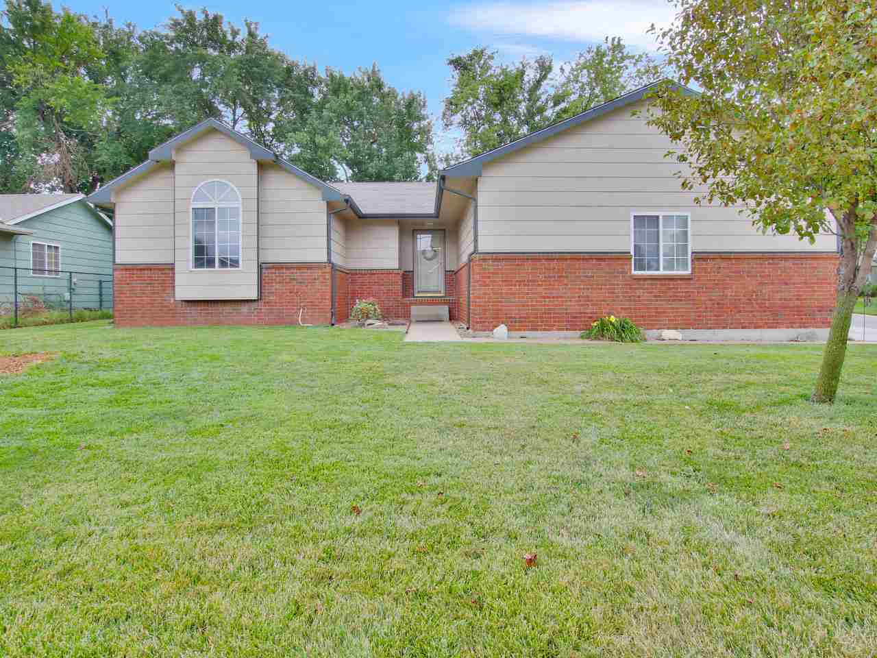 Here is a wonderful west side home in the Maize School District! There are four total bedrooms, thre