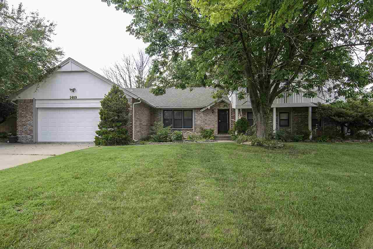 Need some elbow room?  This home is nestled on a lot that is over a half acre!  You'll love the yard
