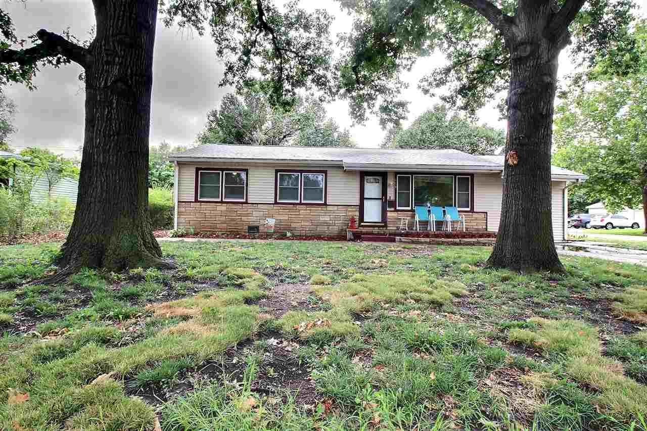 This beautiful four bedroom, two bathroom home, sits on a large corner lot with mature trees and has