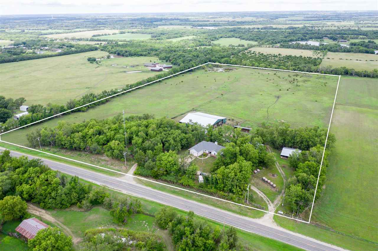 28.8 acres on blacktop! Come see this 3514 square foot home and horse property with acreage and a po