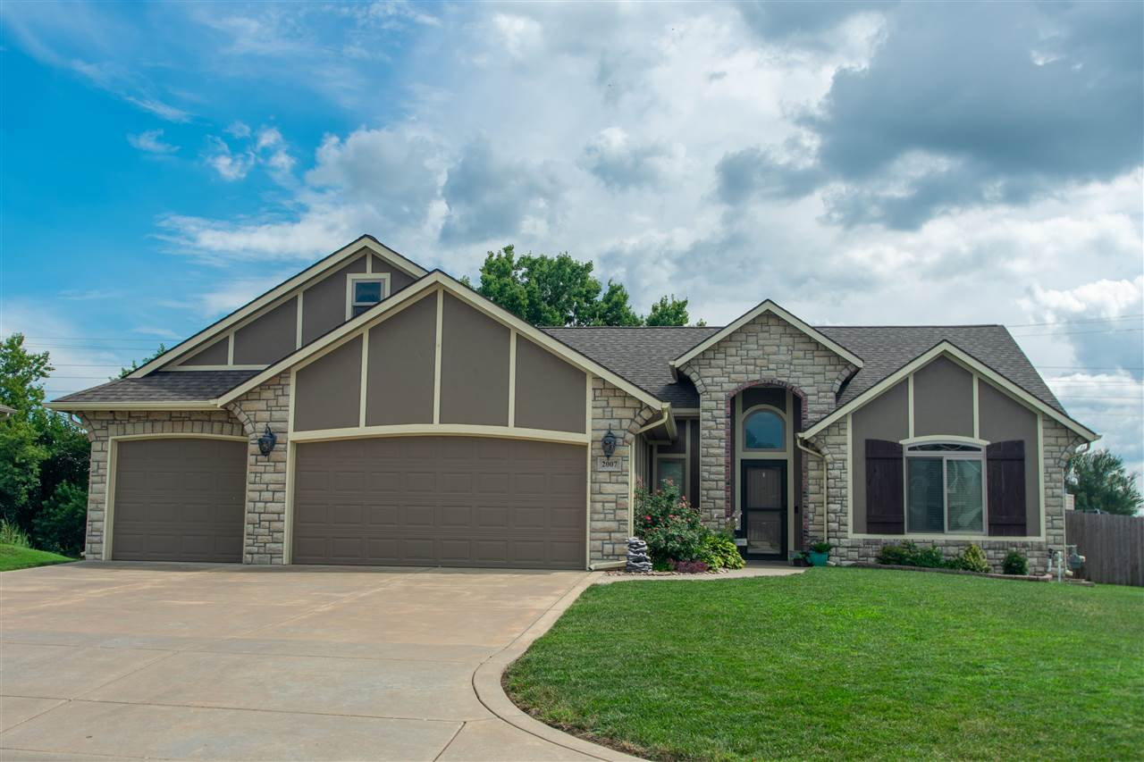 You'll find this stunning home resting on a quiet cul-de-sac in Mulvane! The outside is welcoming wi