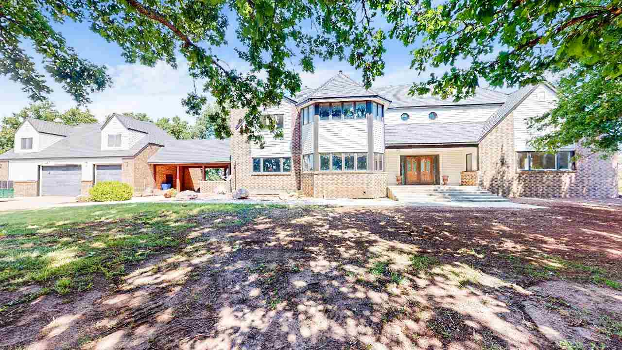 This custom built home is one of a kind! Tudor style home with a 3 car oversized detached 30 x 50 ga
