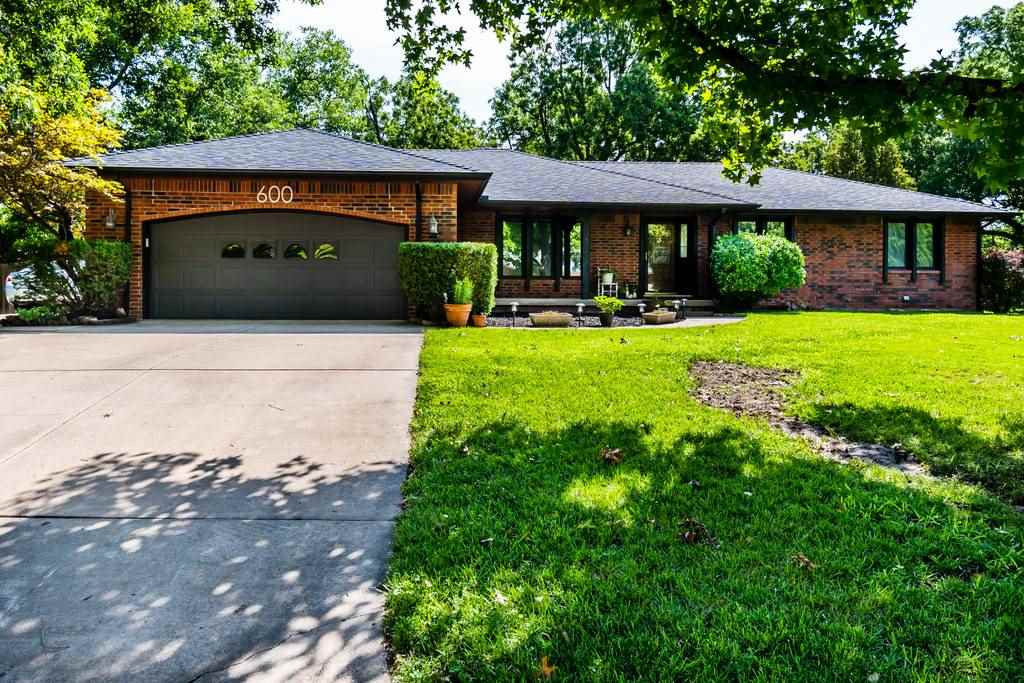 On a sprawling 1.1 acre lot, this beautiful brick ranch home in Haysville has so many features and a