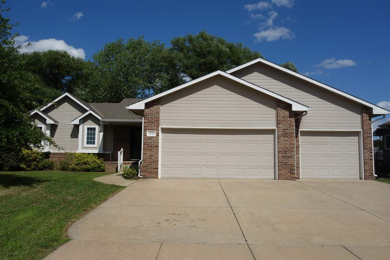 This spacious 4 bedroom, 3 1/2 bath home is located in the Maize school district.  The school bus ac