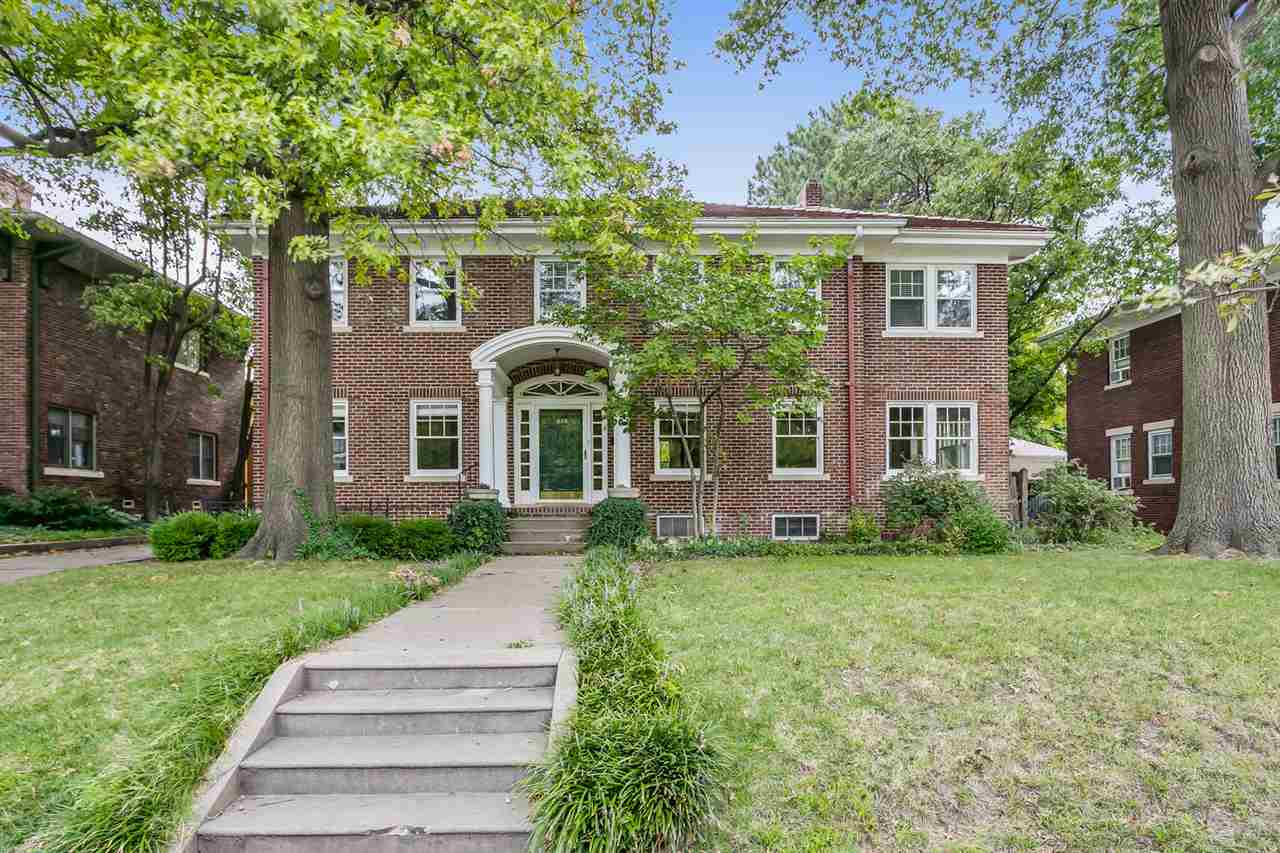 Abundant character and charm in this 1929 College Hill brick home with clay tile roof. Over 3,500 sq