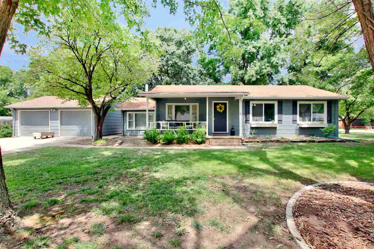 Cute home with original hardwood floors and a corner lot with LOTS of mature trees and shade!  Windo