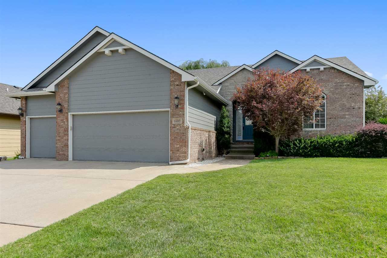 Impeccably maintained open floor plan ranch located in Wichita yet in the Andover Central school district.  This former model home has brand new Stain-Master waffle carpet and pad (Please remove shoes or wear provided booties when viewing) and neutral paint palate throughout.  Exterior was painted in 2019 as well as a new Class 4 IR 50 year roof and gutters.  You will surely be pleased when your insurance agent shares the amount of money you will save due to this roof. The home boasts an open floor plan in the living areas with 10' ceilings yet a split bedroom plan for additional  privacy. Master bedroom has large windows and 12 foot coffered ceiling. Master bath has 2 vanities separated by the whirlpool tub, ceiling fan and separate shower. Large closet with 3rd seasonal rack as well as a second bi-fold closet. Beautiful timeless knotty alder wood throughout.  Home is wired for security cameras (existing cameras are excluded) and has a security system installed. View out basement truly is large enough for two living spaces or a family room and game room.  Great storage in the mechanical room. Bedroom and bath complete the area.  Covered composite deck accessed from the dining space with stairs to patio area or you can access the patio area from the mid-level walk out.  With mature trees and landscaping and the corner lot location close to Kellogg, K-96 and the turnpike you are just a hop skip and jump from being where you want to be.  Come see this wonderful home, you won't be disappointed.