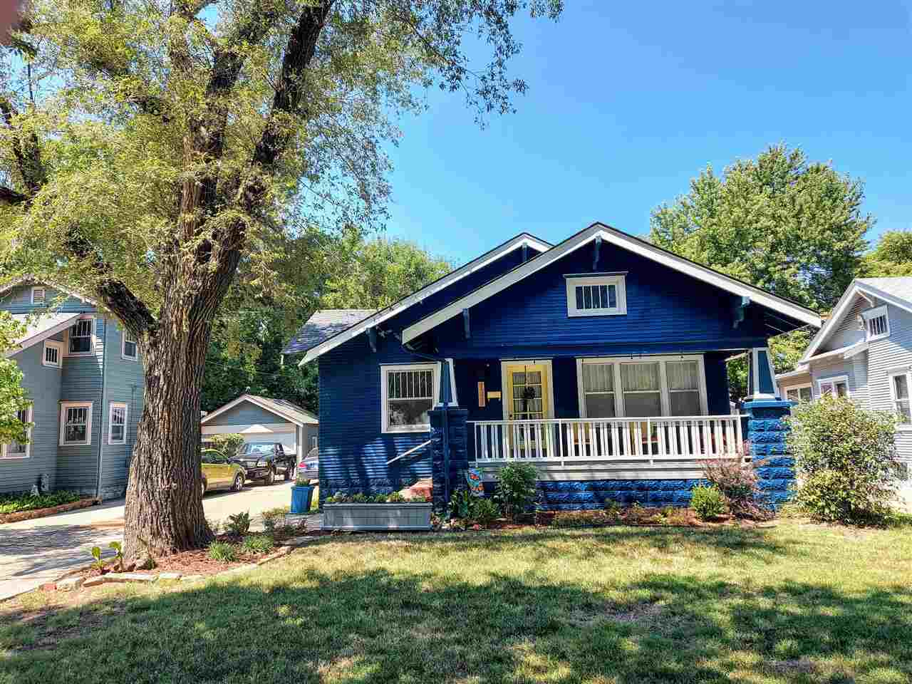 Adorable Riverside Bungalow with new exterior paint, new front porch, new back deck, gorgeous landsc