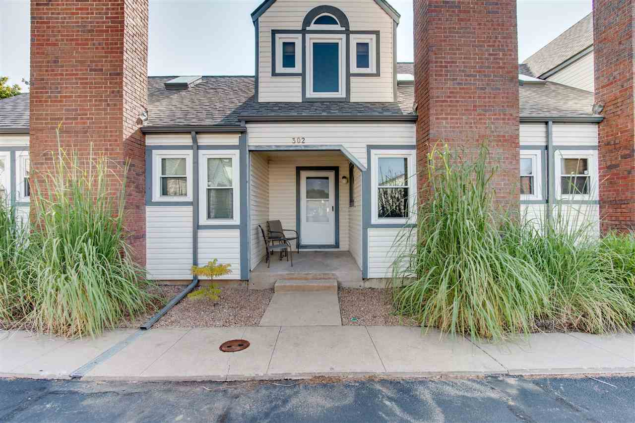 Enjoy maintenance free living in this 3 bedroom Townhome. It features vaulted ceiling and brick wood