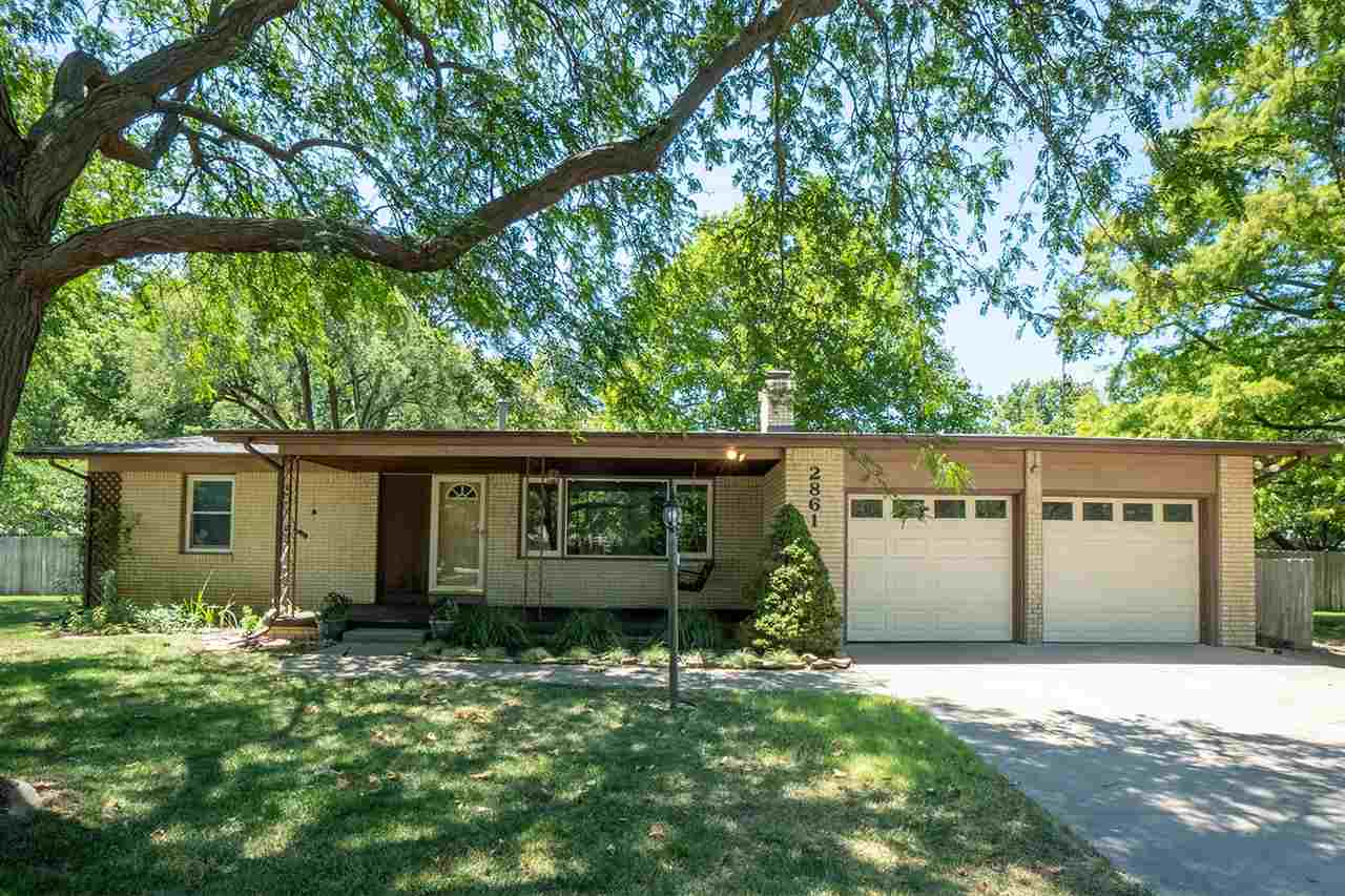 Charming 4 bedroom ranch located on nearly a half-acre corner lot. The exterior features an attached