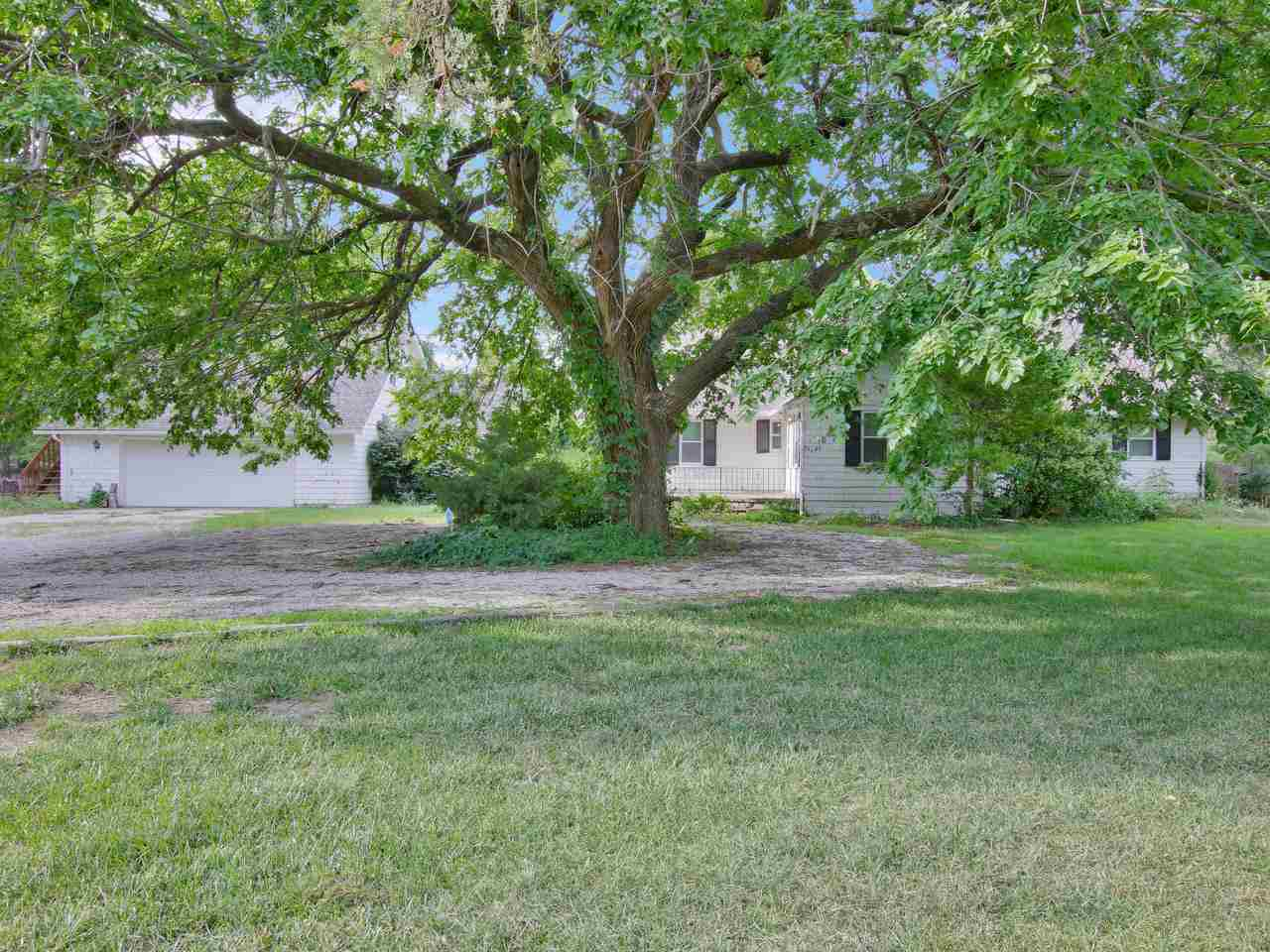 Spacious home on a 1/2 acre lot that is ready for your personal touches! This home is full of potent