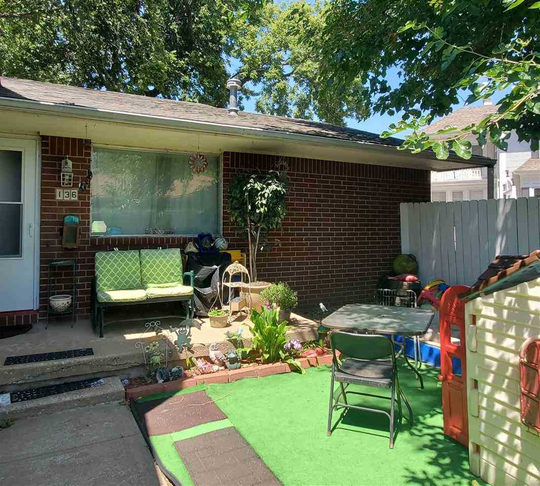 Well kept, move-in ready, all brick twin home. Pride of ownership - two full bathrooms with newer to