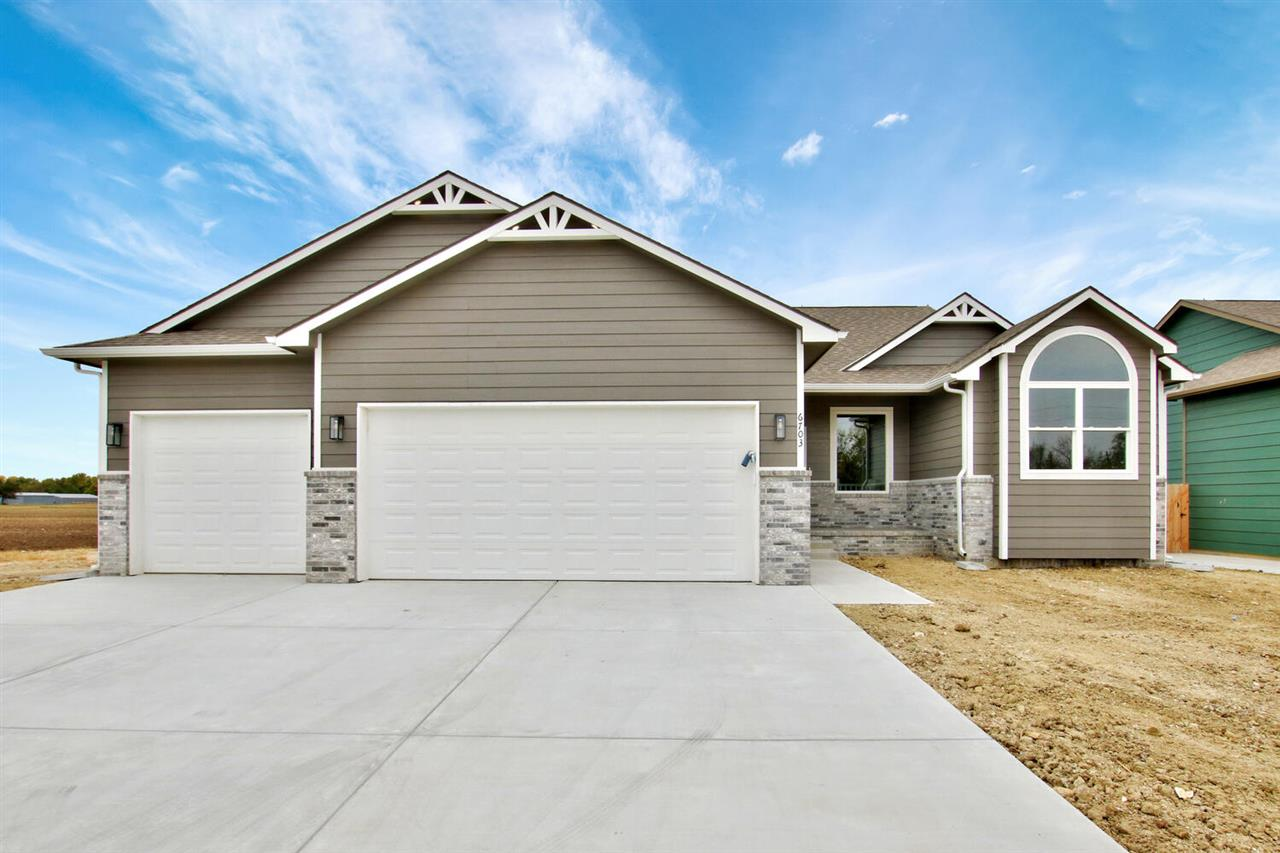 Don't miss this lovely new construction ranch at Cambridge Valley, located in Park City and zoned for Valley Center School District.  This home features a split bedroom floorplan with many extras throughout the main floor, which has 1603 square feet.  Kitchen features granite counters, above and below cabinet LED lighting, 3x8 island, pendant lighting and large walk-in pantry. Large dining room has sliding Pella brand door with built-in blinds, which leads out to the covered composite deck. Living room has vaulted ceilings and is adjacent to beautiful open staircase leading to the basement. Luxury vinyl tile flooring will be laid throughout the main traffic areas of the home, making for easy cleaning and maintenance. Master suite has huge walk-in closet and private bathroom with double vanity with granite counters, linen closet and oversized walk-in shower with bench and slide bar. Main floor laundry area features folding counter, hang bar, two cabinets for storage, and door leading into the master suite. As you walk in from the garage, there is a large custom-built drop zone with bench, hooks and cubbies to keep you organized. On the opposite side of home, there are two bedrooms, full bathroom with granite counters, linen closet and coat closet. You'll love the large Pella brand windows and LED recessed lighting throughout the open floorplan. Viewout basement could be finished to add two additional bedrooms, bathroom and family room with wet bar. The 3 car garage is 24' deep in main bay and includes opener and keypad on the main door. This builder included so many extras throughout the home to benefit the future homeowner - check the spec sheet for the full list.  This home is located in Valley Center school district, and qualifies for USDA RD loans and Park City new home incentive.